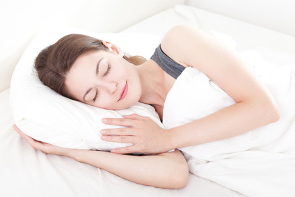 Sleeping woman pictured. sleep peacefully with treatment of OMDs.