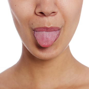 No, this isn't tongue thrust, it's just a woman sticking out her tongue